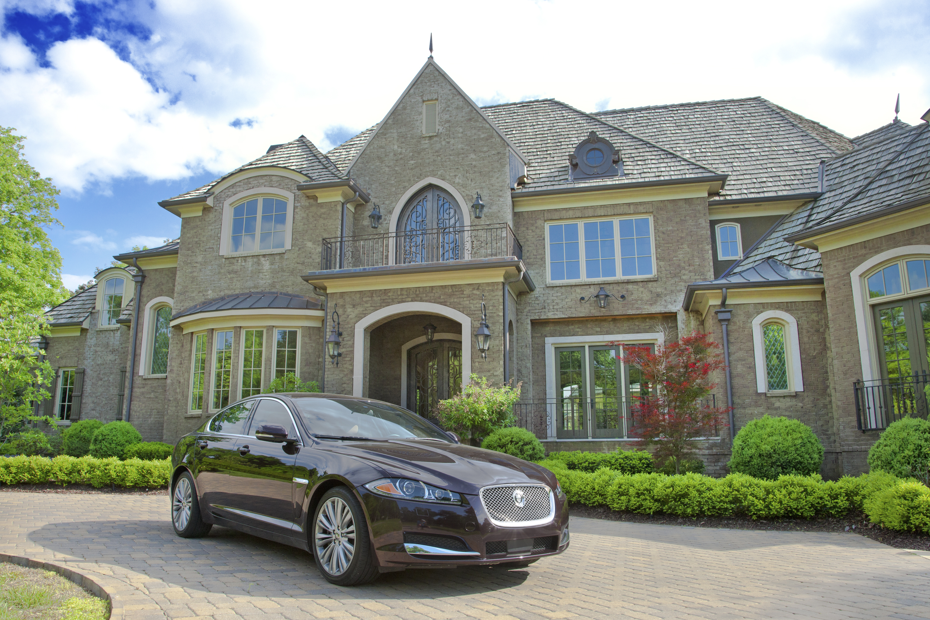 Manor-Home-Exterior-with-Jag.jpg